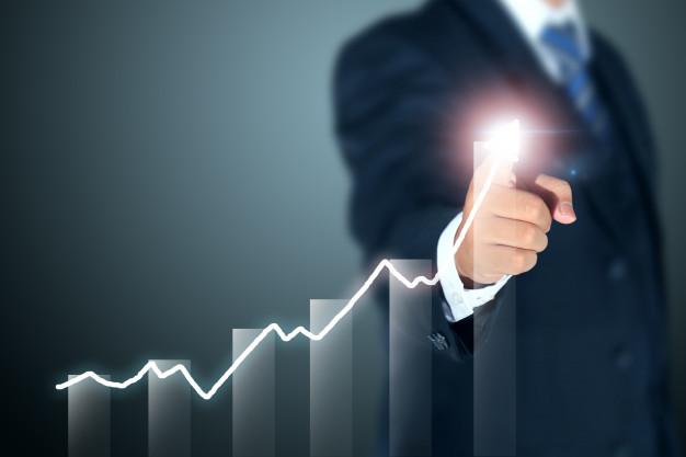 businessman-pointing-graph-success_13920-990