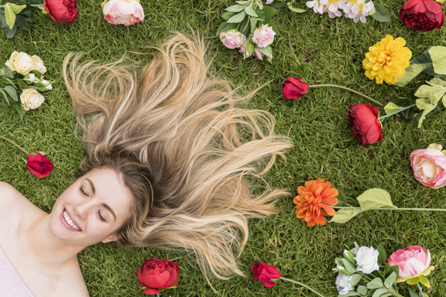 cheerful-lady-lying-grass-blooms_23-2148029690