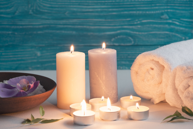 spa-wellness-setting-with-sea-salt-illuminated-candles_23-2147867857