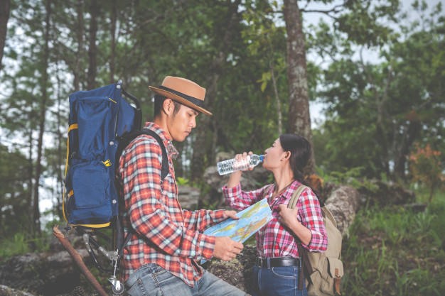couples-drink-water-see-map-tropical-forest-along-with-backpacks-forest-adventure-traveling-climbing-hike_1150-15250